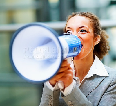 Buy stock photo Young African American business woman speaking into a megaphone