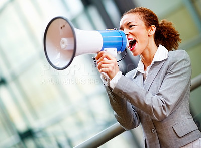 Buy stock photo Beautiful African American business woman yelling into a bullhorn