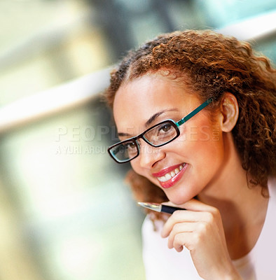 Buy stock photo Closeup of a sweet young business woman wearing spectacles