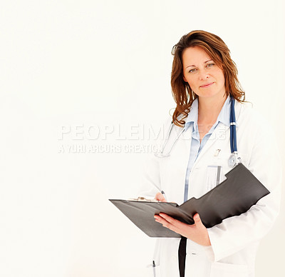 Buy stock photo Portrait of a pretty middle aged female doctor holding a notepad isolated on white