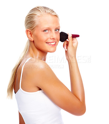 Buy stock photo Portrait of a lovely young woman applying make up over white background