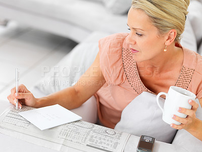 Buy stock photo Mature woman at home seeking for jobs in the newspaper