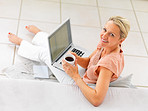 Top view of mature woman using laptop at home