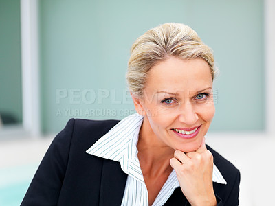 Buy stock photo Portrait of a happy middle age business woman with hand on chin