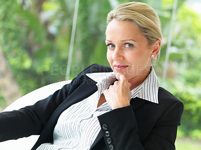 Buy stock photo A professional mature business woman sitting on a chair