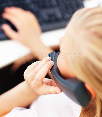 Buy stock photo Closeup of a secretary using a telephone with computer in office
