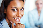 Closeup of confident young businesswoman smiling