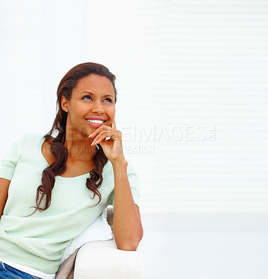 Buy stock photo Thoughtful African American woman looking up at copy space