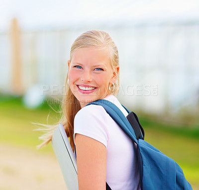 Buy stock photo Young blond student with folder and bag at the campus
