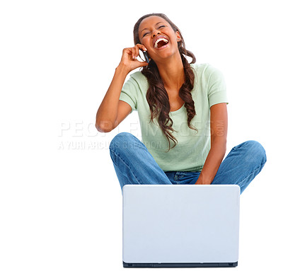 Buy stock photo African American girl using a laptop, speaking on the cellphone on white