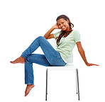 Happy young woman sitting isolated on a chair over white