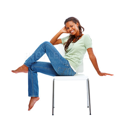 Buy stock photo Pretty young African American woman posing on a chair isolated against white