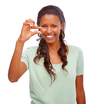 Buy stock photo Portrait of a happy young African American female indicating a little bit against white background