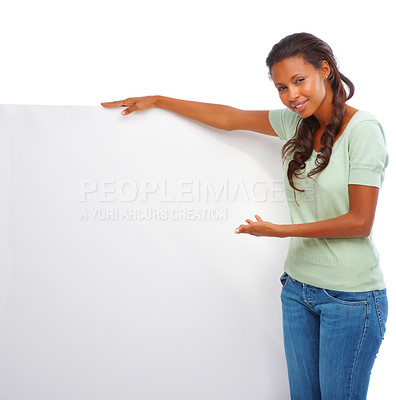 Buy stock photo Portrait of a cute young African American displaying a blank billboard on white