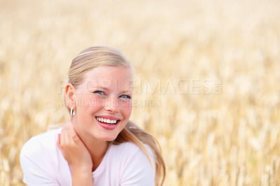 Buy stock photo Closeup of a cheerful young woman smiling at a field