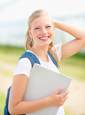 Buy stock photo Lovely young female student posing outdoors
