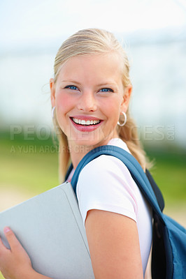Buy stock photo Portrait of a cute young female student smiling while outdoors