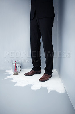 Buy stock photo Low section of a business man trapped in the corner of a wet floor