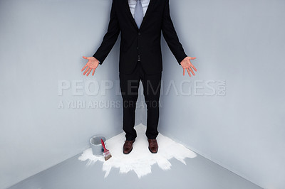 Buy stock photo Low section of a business man trapped in the corner of a wet painted floor