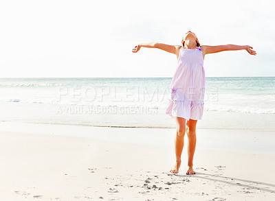 Buy stock photo Young girls enjoying at the sea shore with her hands outstretched