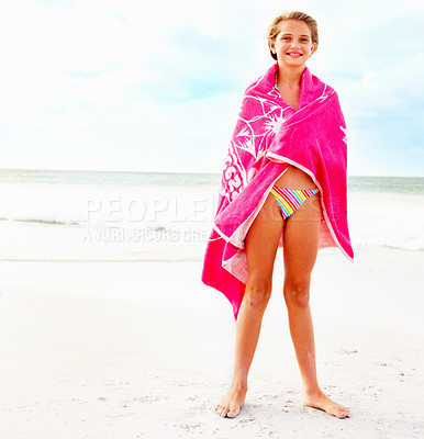 Buy stock photo Full length of a young girl in a bikini covered in a pink towel at the sea shore