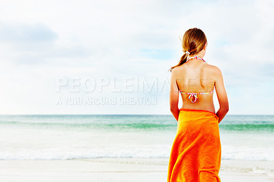 Buy stock photo Beach vacation - Rear view of a young girl in a bikini on the sea shore
