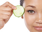 Revitalizing her eyes with cucumber
