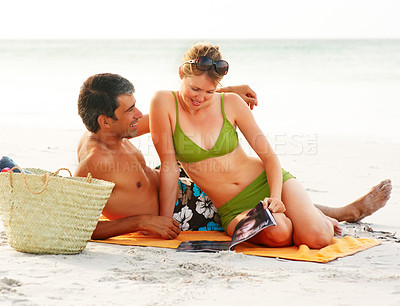 Buy stock photo Happy cute couple in swimwear relaxing at the beach