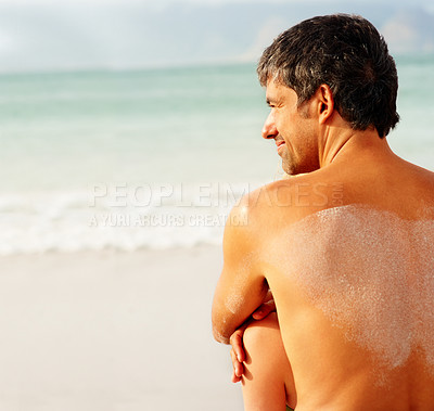 Buy stock photo Rear view of a man sitting on a sea shore