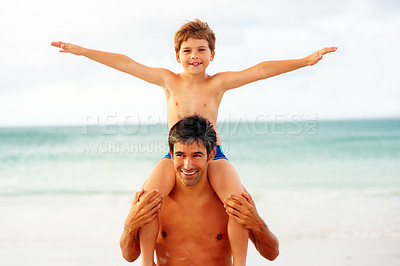 Buy stock photo Happy son having a ride on his father's shoulders while at the beach