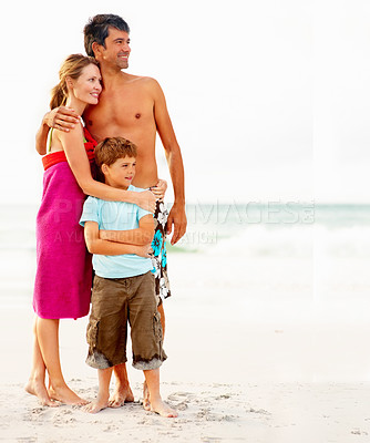 Buy stock photo Portrait of a family smiling while at the sea shore, looking away