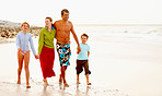 Happy family on a vacation, walking on the sea shore