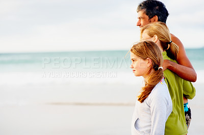 Buy stock photo Beach vacation - Happy family of four taking a strolling on the sea shore