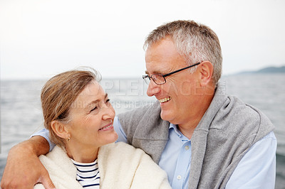 Buy stock photo Mature couple enjoying themselves at the ocean side