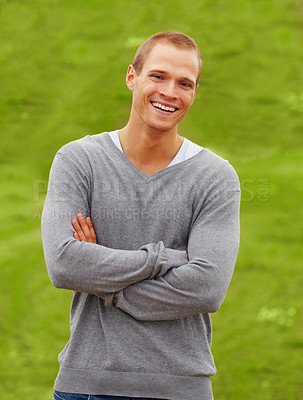 Buy stock photo Happy young man smiling in the park