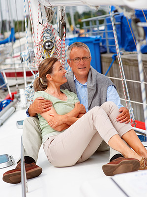 Buy stock photo Senior woman sitting comfortably with her husband on a sailboat