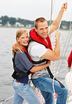 Young couple holding a boat line while on an adventurous sea voyage