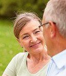 Mature woman smiling at her husband while at the garden