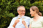 Happy old couple having a glass of champagne while outdoors