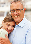 Closeup portrait of a mature couple hugging eachother outdoors