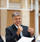 Successful senior business man showing a thumbs up