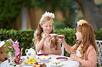 Having a make-believe tea party