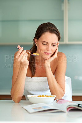 Buy stock photo Beautiful woman having breakfast and reading a mag