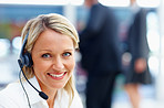 An attractive receptionist with a headset, smiling