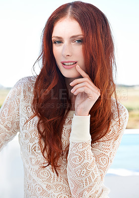 Buy stock photo A lovely young redheaded woman posing outside