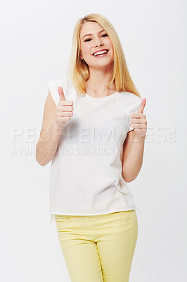 Buy stock photo A gorgeous young blond giving you a thumbs up while isolated on a white background