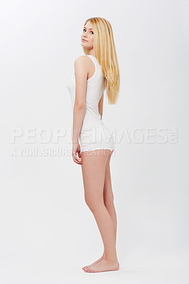 Buy stock photo A pretty young girl modeling sleepwear while isolated on a white background