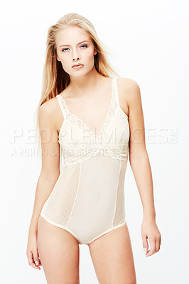 Buy stock photo A pretty young blond woman posing in her underwear while isolated on a white background
