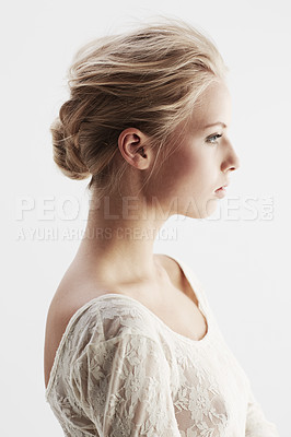 Buy stock photo A stunning young woman looking away thoughtfully