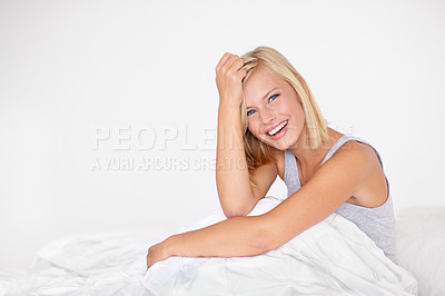 Buy stock photo Portrait of an attractive young woman sitting in bed